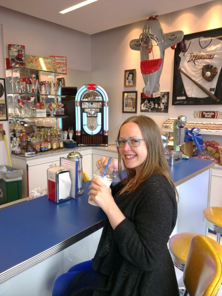 Drinking a milkshake in an American diner