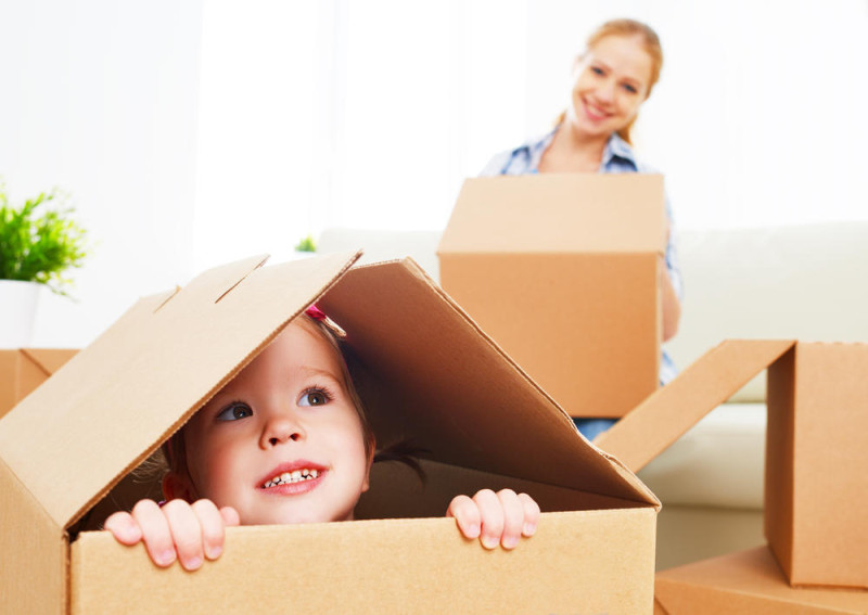 child in a cardboard box